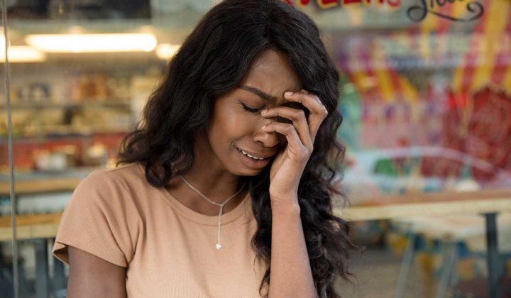 A woman with burnout crying