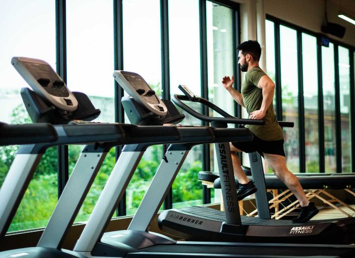 A man exercising on a treadmill - Photo by William Choquette from Pexels